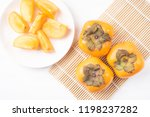 sliced persimmon fruit on white ... | Shutterstock . vector #1198237282