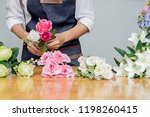 woman hands making flower... | Shutterstock . vector #1198260415