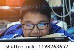 happy asian preteens watching... | Shutterstock . vector #1198263652