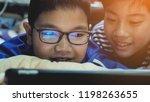 happy asian preteens watching... | Shutterstock . vector #1198263655