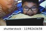happy asian preteens watching... | Shutterstock . vector #1198263658