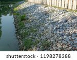 gabion filled with rocks use to ... | Shutterstock . vector #1198278388