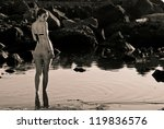 Vintage girl walking in the water looking you - stock photo