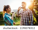 wine growers tasting wine in... | Shutterstock . vector #1198378312