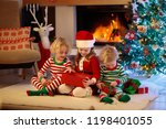 children at christmas tree and... | Shutterstock . vector #1198401055