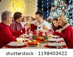 family with children eating... | Shutterstock . vector #1198403422