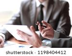 close up of business partners... | Shutterstock . vector #1198404412