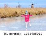 child ice skating on frozen... | Shutterstock . vector #1198405012