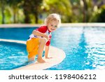 child playing in swimming pool. ... | Shutterstock . vector #1198406212