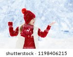 child in red hat playing in... | Shutterstock . vector #1198406215