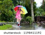 kid playing out in the rain.... | Shutterstock . vector #1198411192