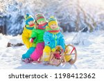 little girl and boy enjoying... | Shutterstock . vector #1198412362
