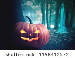 Stock photo halloween design forest pumpkins horror background with autumn valley with woods spooky tree 1198412572