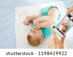 parent taking photo of a baby... | Shutterstock . vector #1198419922