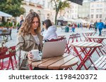 two woman in cafe sitting at... | Shutterstock . vector #1198420372
