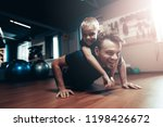 man is doing push ups in gym... | Shutterstock . vector #1198426672