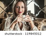 beautiful woman drinking tea | Shutterstock . vector #119845012