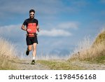 an athlete runner with a beard...   Shutterstock . vector #1198456168