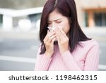 woman feel sneezing and wear... | Shutterstock . vector #1198462315