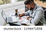 bearded hipster man sits at... | Shutterstock . vector #1198471858
