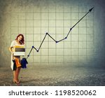 happy young woman carrying... | Shutterstock . vector #1198520062