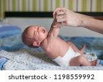 mother or masseuer massaging... | Shutterstock . vector #1198559992
