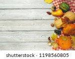 pumpkin on old rustic wooden... | Shutterstock . vector #1198560805