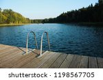 small bridge by lake | Shutterstock . vector #1198567705