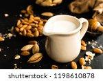 homemade almond milk in jug.... | Shutterstock . vector #1198610878