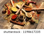 wood spoons with pepper balls ... | Shutterstock . vector #1198617235