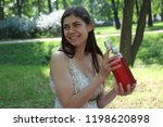 young smiling girl with a...   Shutterstock . vector #1198620898
