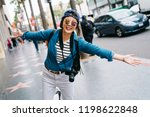 female tourist joyfully opening ... | Shutterstock . vector #1198622848
