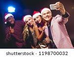 glamorous multicultural friends ... | Shutterstock . vector #1198700032