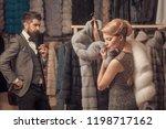 woman in fur coat with man ...   Shutterstock . vector #1198717162
