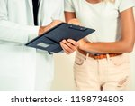 male doctor and female patient...   Shutterstock . vector #1198734805