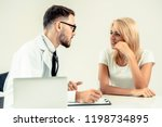 male doctor talks to female...   Shutterstock . vector #1198734895