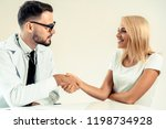 male doctor doing handshake...   Shutterstock . vector #1198734928