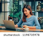 asian woman drinking coffee in  ... | Shutterstock . vector #1198735978
