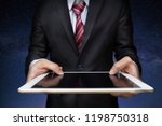 business man with tablet on... | Shutterstock . vector #1198750318