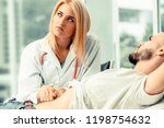woman doctor is talking and...   Shutterstock . vector #1198754632