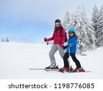 mother and son on skis standing ... | Shutterstock . vector #1198776085