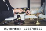 Stock photo businessman and male lawyer or judge consult having team meeting with client law and legal 1198785832