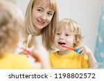 mother teaching kid teeth...   Shutterstock . vector #1198802572