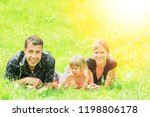family outdoors playing in the... | Shutterstock . vector #1198806178