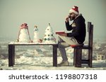 man santa drinking coffee on... | Shutterstock . vector #1198807318