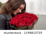 brunette girl with a bouquet of ... | Shutterstock . vector #1198813735