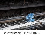 a blue flower on the piano... | Shutterstock . vector #1198818232