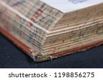 book worn pages tattered spine...   Shutterstock . vector #1198856275