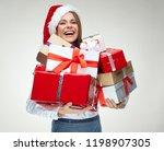 Happy Woman Wearing Santa Hat...