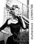 sexy woman smoking a cuban... | Shutterstock . vector #119894788
